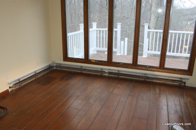 Pine floor worn and stained