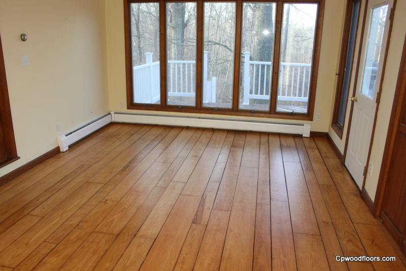 Pine floor worn and stained refinished