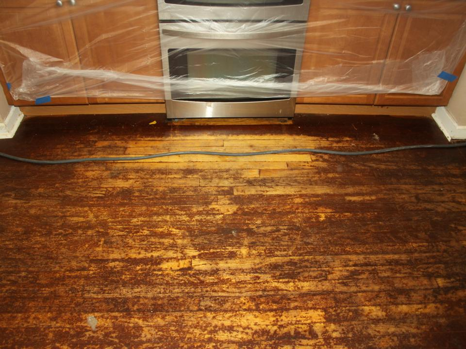 WORN KITCHEN OAK FLOOR BEFORE