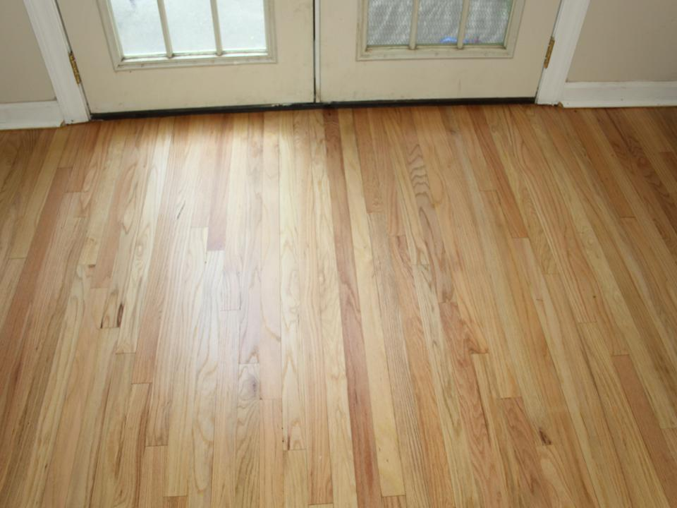 WORN OAK FLOOR BY DOOR AFTER
