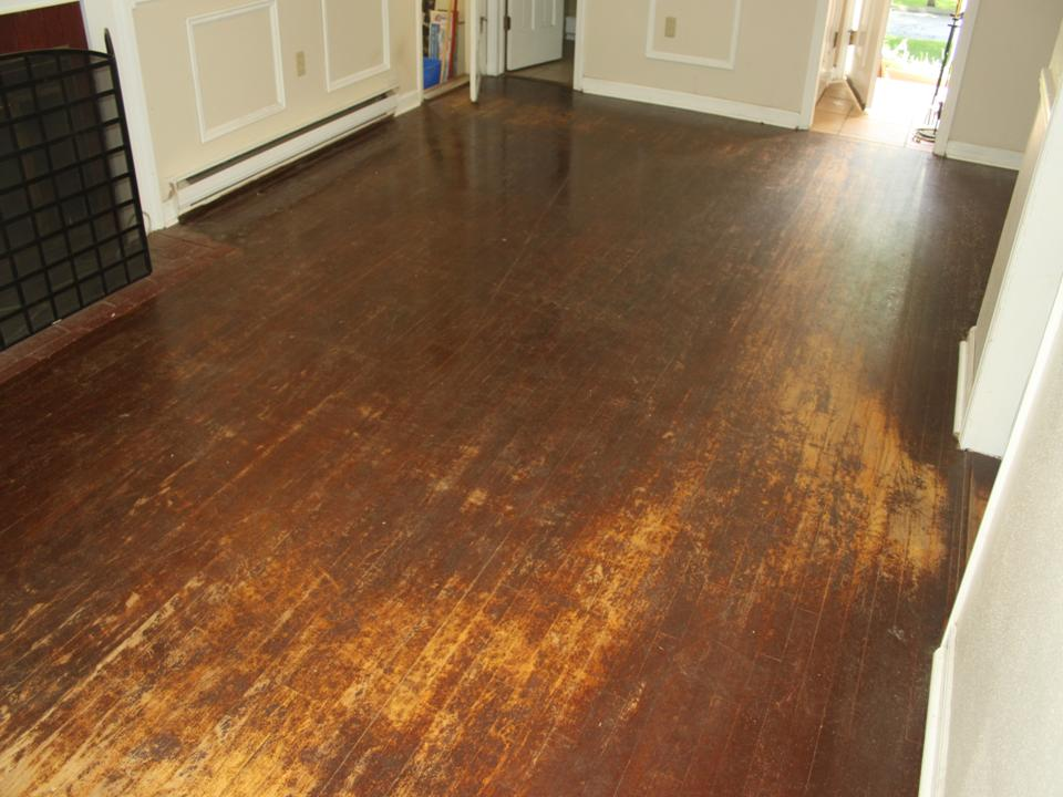 WORN FAMILY ROOM OAK FLOOR BEFORE