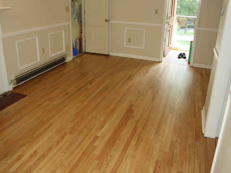 WORN FAMILY ROOM OAK FLOOR AFTER