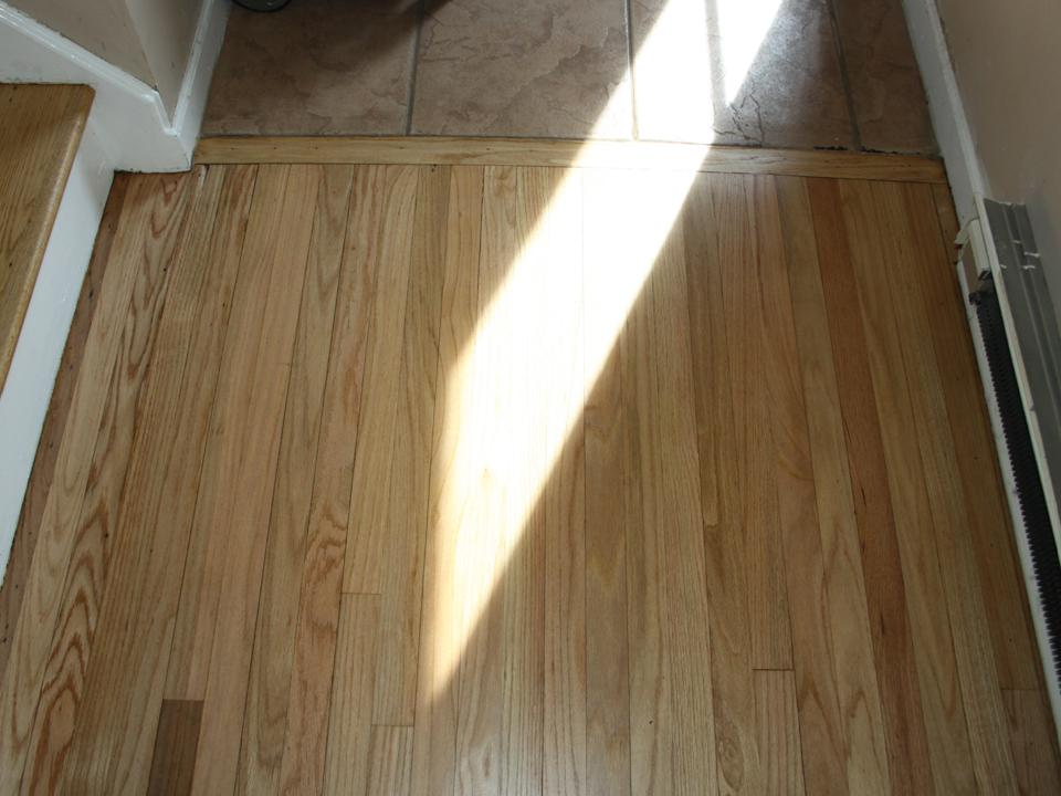 WORN AND FOYER OAK FLOOR AFTER