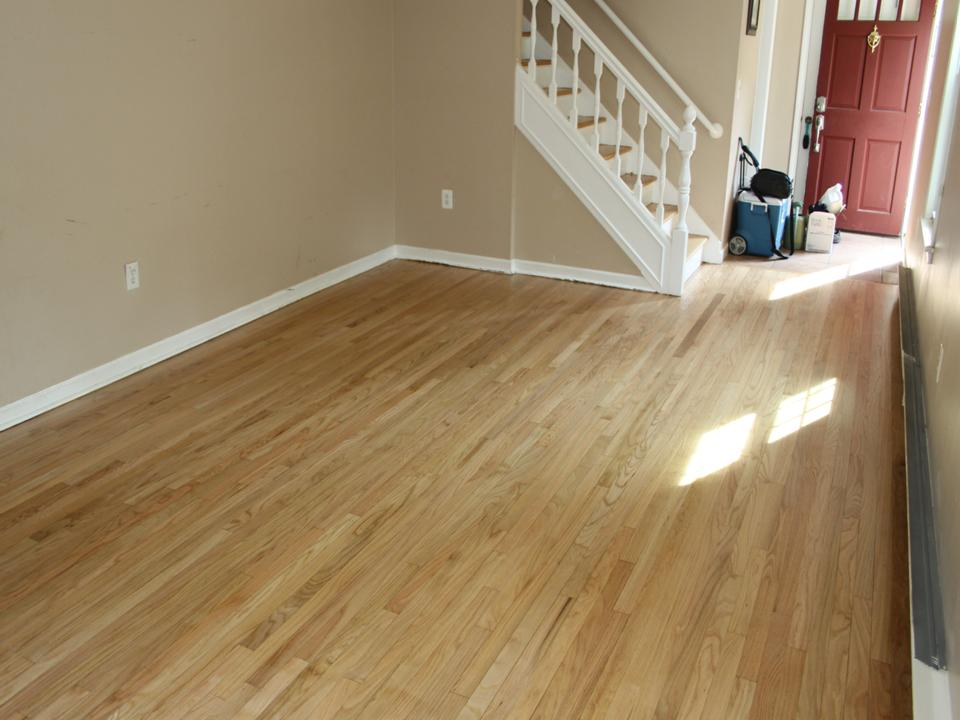 WORN AND STAINED LIVING ROOM OAK FLOOR AFTER