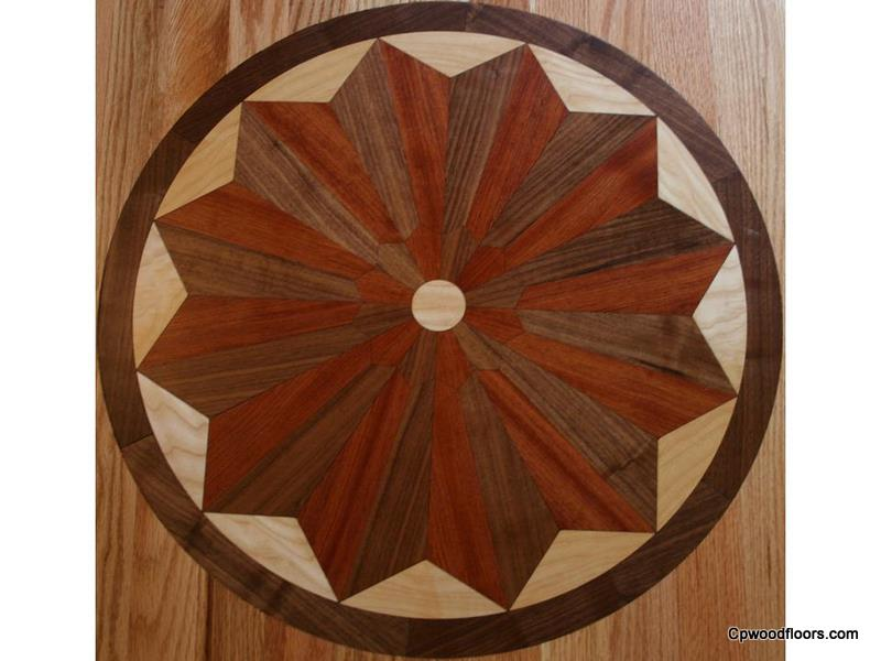 Hand cut wood floor medallion