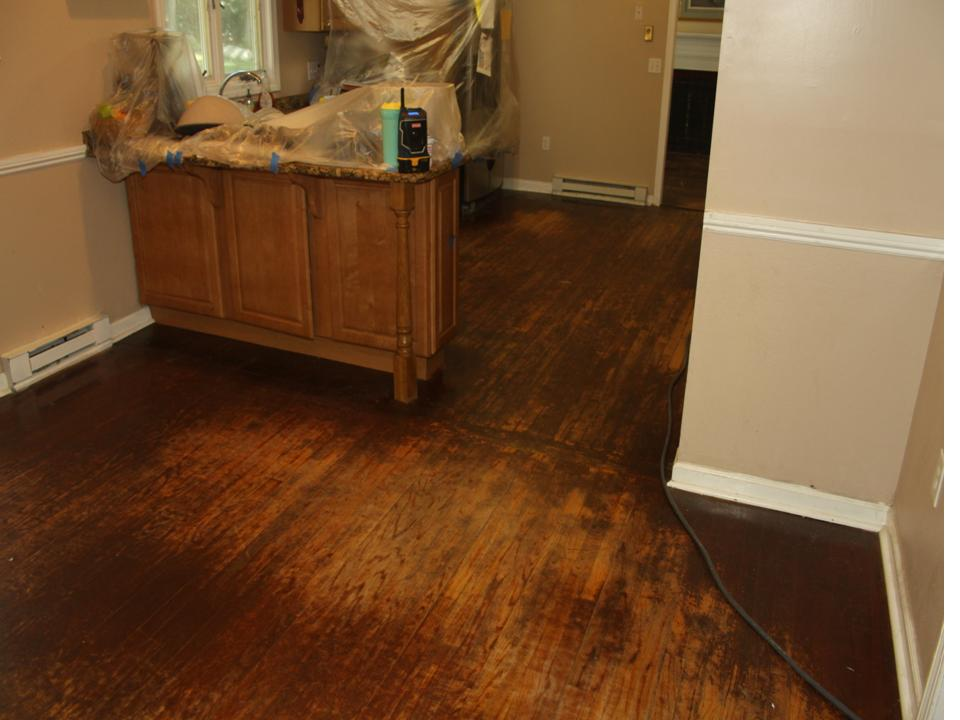 WORN AND STAINED DINING ROOM OAK FLOOR BEFORE