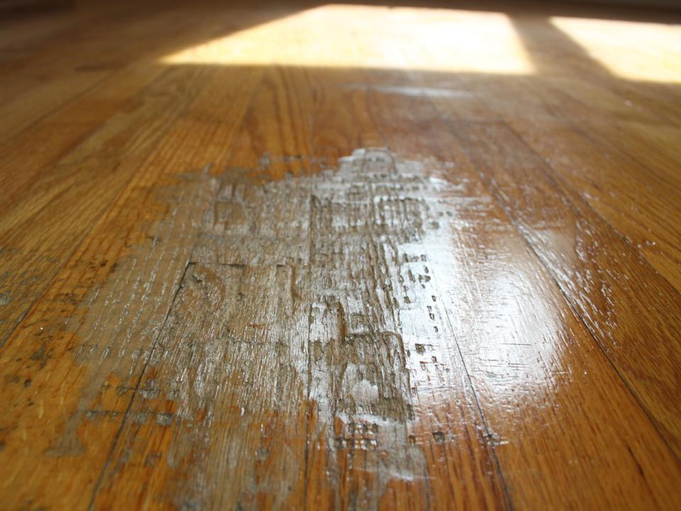 Wood floor deeply damage from piano stool made new