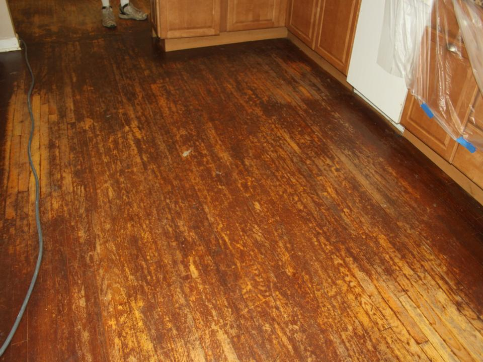 WORN AND STAINED KITCHEN OAK FLOOR BEFORE