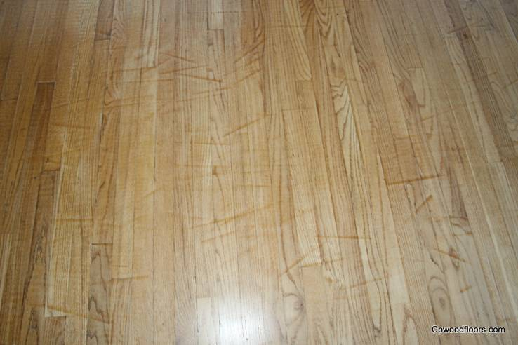 WOOD FLOOR SANDING DRUM MARK DAMAGE CLOSE UP