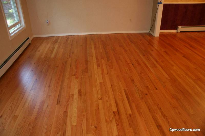 Beveled stained waxed wood floor refinished