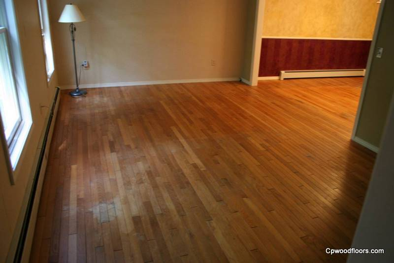 Beveled stained and worn waxed wood floor