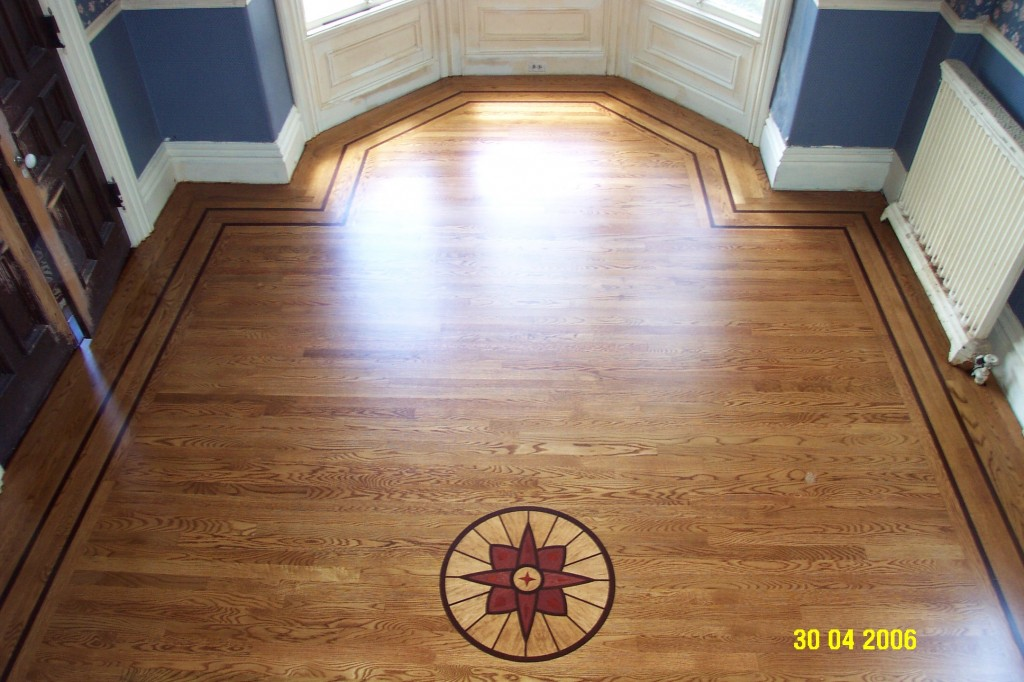 Living room custom medallion and walnut accent strips