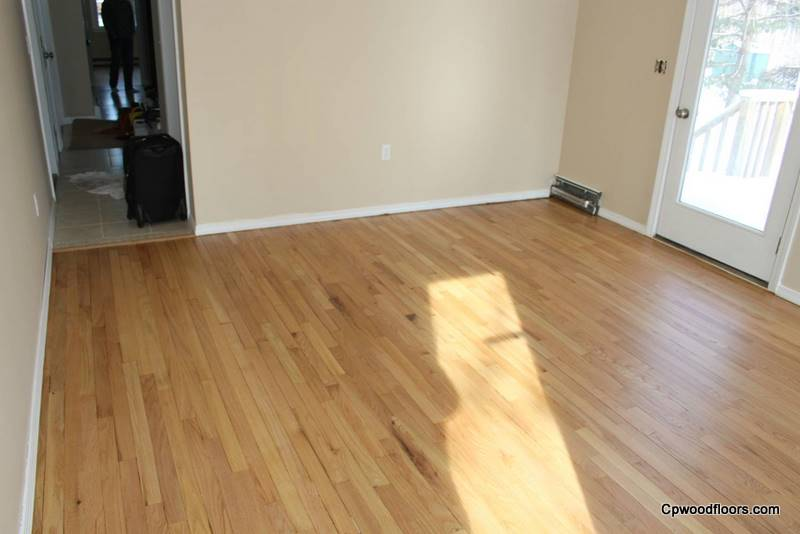 Stained damaged family room wood floor refinished