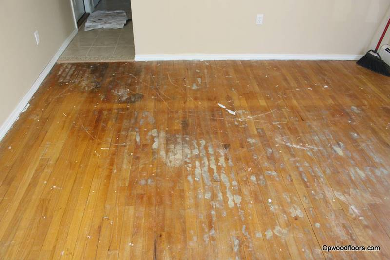 Stained damaged family room wood floor
