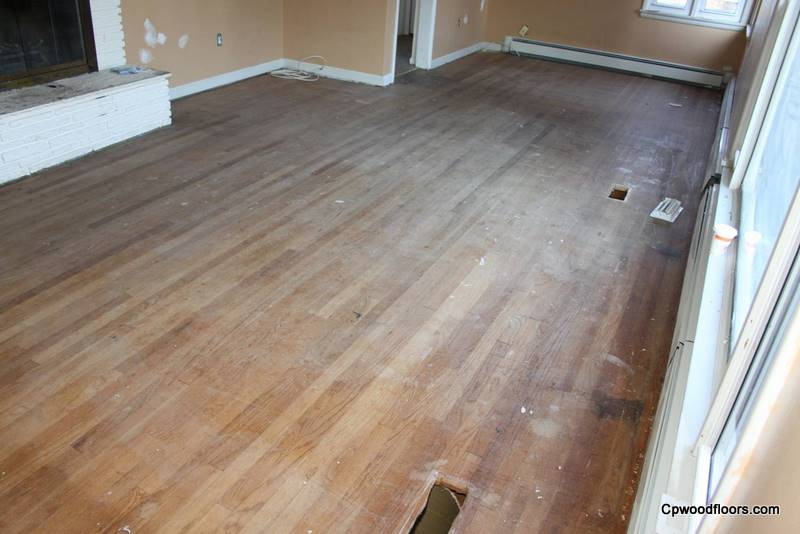 Worn stained oak floor with vent holes