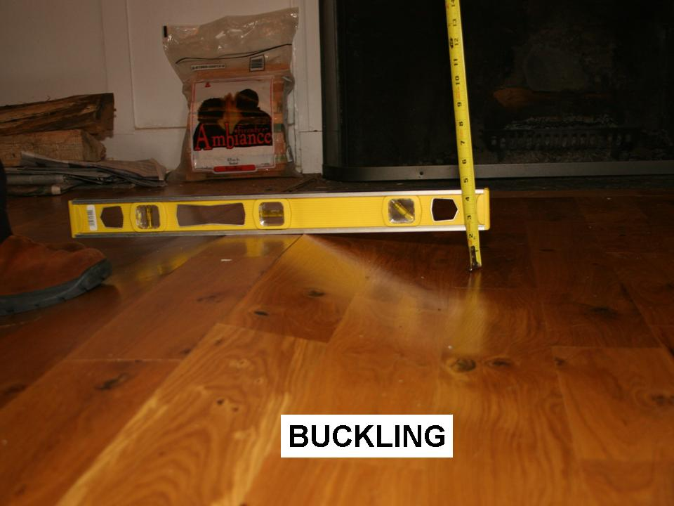 Wood floor buckling